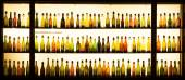 Old beer bottles in a lightened window display of a brewery in Cologne — Foto de Stock