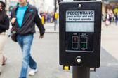 Pedestrian button at a pedestrian crossing in London — Stock Photo