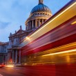 St. Pauls Cathedral in London, UK, with light trails of a London Bus — Stock Photo #54405743