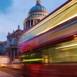 St. Pauls Cathedral in London, UK, with light trails of a London Bus — Stock Photo #54406809
