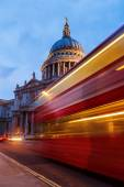 St. Pauls Cathedral in London, UK, with light trails of a London Bus — Stock Photo