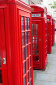 Traditional red phone boxes in London, UK — Stock Photo