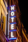 Neon sign of a hotel at night — Stock Photo