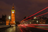 London with Big Ben and light trails of traffic at night — Stock Photo