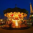 Antique merry go round with the Eiffel Tower in the background at night in Paris, France — Stock Photo #54501969