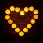 Lightened tealights in heart shape — Stock Photo