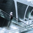 Blurred man on an escalator of a modern metro station — Stock Photo #54511239