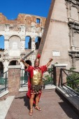 Colosseum in Rome, Italy, with a historic costumed man — Stok fotoğraf