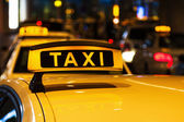 Lighted taxi sign on a roof of a German taxi — Stockfoto