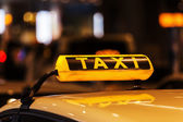 Lighted taxi sign on a roof of a German taxi — Photo