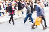 People in motion blur crossing a street in London City — Stock Photo