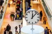 Clock on an information point in a shopping mall — Stock Photo