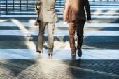 Two business people walking in an office area — Stock fotografie