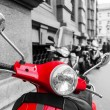 Red scooter with black and white surrounding — Stock Photo #54573051