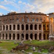 Постер, плакат: At the Theatre of Marcellus in Rome Italy at sunset