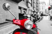 Red scooter with black and white surrounding — Foto Stock