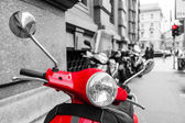 Red scooter with black and white surrounding — Photo