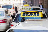 Row of taxis in the city — Stock Photo
