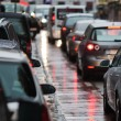 Cars in a traffic jam at rush hour in the rainy city — Stock Photo #54586127