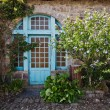 Picturesque from roses overgrown cottage in Brittany, France — Stock Photo #54587645