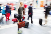 People in motion blur at a railroad station — Stock Photo