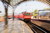 Creative zoom picture of a train arriving at a train station — Stock Photo