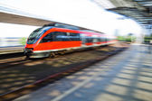 Train arriving at a train station in motion blur — 图库照片