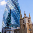 Skyscraper Gherkin and old church in the City of London — Stock Photo #54602415