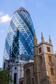 Skyscraper Gherkin and old church in the City of London — Stock Photo