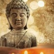 Textured picture in vintage style of a Buddha bust with candlelights — Stock Photo #54619387