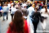 Crowd of people crossing a street — Stock Photo