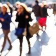 Crowd of people on a city square out of focus — Stock Photo #54646887