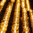 Rows of tealights with closed depth of field — Stock Photo #54657825