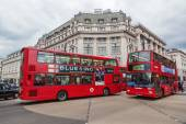 Traditional red London buses at Oxford Circus in London, UK — Foto de Stock