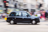 London taxi in motion blur — Stock Photo