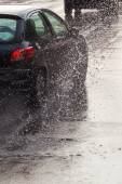Car traffic on a wet street — Stock Photo
