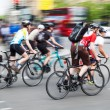 Group of cyclists in motion blur in the city traffic — Stock Photo #54670903