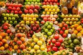 Market stall with fruits and vegetables in the market hall La Boqueria in Barcelona, spain — Foto Stock