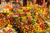 Market stall with fruits and vegetables in the market hall La Boqueria in Barcelona, spain — Stock Photo