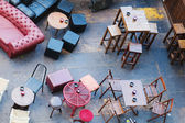 Motley chairs and tables of a street cafe in top view — Stock Photo
