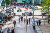 On a square with clocks at Canary Wharf in London, England — Foto Stock