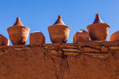 Antique vessels on an old mud wall in Morocco — Stock Photo