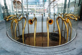 Modern trumpet like sculptures at the Piazza Gae Aulenti in Milan, Italy — Stock Photo