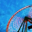 Ferris wheel against clouded sky at blue hour — Stock Photo #54927289