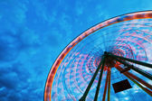 Ferris wheel against clouded sky at blue hour — Stock Photo
