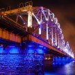 Blue illuminated railroad bridge over the river Daugava in Riga, Latvia — Stock Photo #54935961