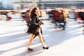 People in the city in creative motion blur — ストック写真