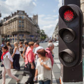 Traffic lights in the foreground with a street scene in the blurred background in London, UK — Stock Photo