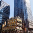 Постер, плакат: Pub The Albert in front of modern skyscrapers in London UK