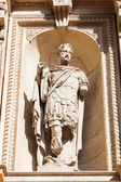 Old sculpture at a historical building in Milan, Italy — Stock Photo